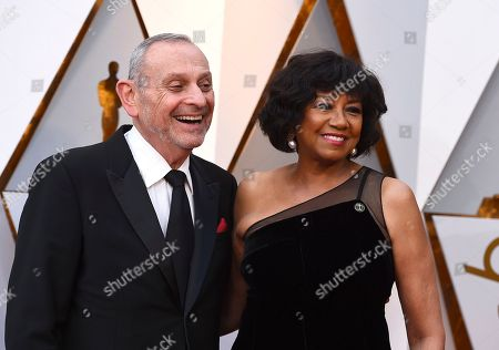 Stock Image of Stanley Isaacs, Cheryl Boone Isaacs. Stanley Isaacs, left, and Cheryl Boone Isaacs arrive at the Oscars, at the Dolby Theatre in Los Angeles