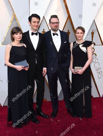 Stock Image of Jan Lachauer, Jakob Schuh. Jan Lachauer, second from left, Jakob Schuh, second from right, and guests arrive at the Oscars, at the Dolby Theatre in Los Angeles