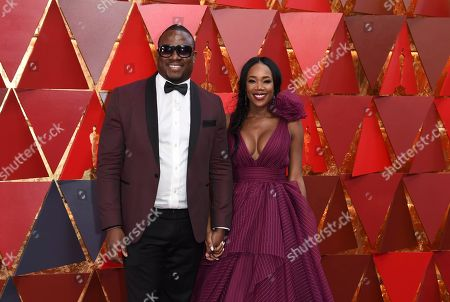 DJ M.O.S., left, and DJ Kiss arrive at the Oscars, at the Dolby Theatre in Los Angeles