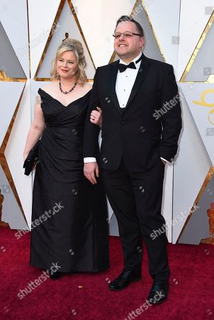 Mike Mulholland, right, and guest arrive at the Oscars, at the Dolby Theatre in Los Angeles