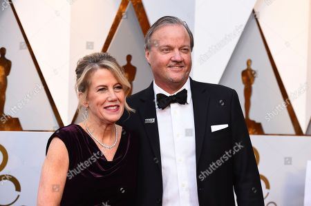 Stock Picture of Lisa Bruce, Dave Evans. Lisa Bruce, left, and Dave Evans arrive at the Oscars, at the Dolby Theatre in Los Angeles