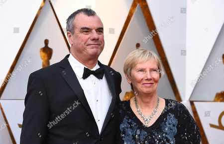 Chris Corbould, left, and guest arrive at the Oscars, at the Dolby Theatre in Los Angeles