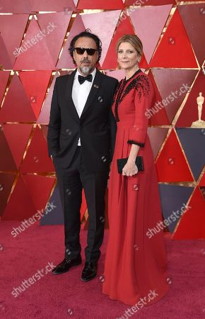 Stock Image of Alejandro G. Inarritu, Maria Eladia Gonzalez. Alejandro G. Inarritu, left, and Maria Eladia Gonzalez arrive at the Oscars, at the Dolby Theatre in Los Angeles