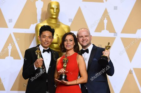 "Kazuhiro Tsuji, from left, Lucy Sibbick, and David Malinowski, winners of the award for best makeup and hairstyling for ""Darkest Hour"", pose in the press room at the Oscars, at the Dolby Theatre in Los Angeles"