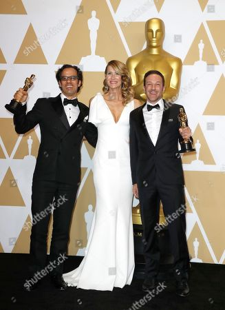 "Laura Dern (C) poses with Dan Cogan (L) and director Bryan Fogel (R), winners of the ""Best Documentary Feature"" award for 'Icarus,' poses in the press room during the 90th annual Academy Awards ceremony at the Dolby Theatre in Hollywood, California, USA, 04 March 2018. The Oscars are presented for outstanding individual or collective efforts in 24 categories in filmmaking."