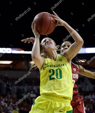Stock Image of Oregon's Sabrina Ionescu shoots as Stanford's Kiana Williams follows during the second half of an NCAA college basketball game in the finals of the Pac-12 Conference women's tournament, in Seattle. Ionescu led all scorers with 36 points and Oregon won 77-57