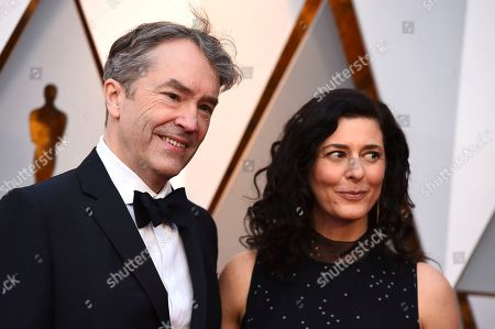 Carter Burwell, Christine Sciulli. Carter Burwell, left, and Christine Sciulli arrive at the Oscars, at the Dolby Theatre in Los Angeles