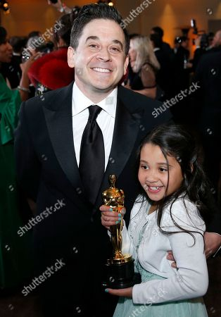 """Gary A. Rizzo, winner of the award for best sound mixing for """"Dunkirk"""", left, attends the Governors Ball after the Oscars, at the Dolby Theatre in Los Angeles"""