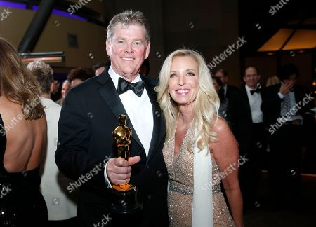 "Richard R. Hoover, winner of the award for best visual effects for ""Blade Runner 2049"", left, and guest attend the Governors Ball after the Oscars, at the Dolby Theatre in Los Angeles"