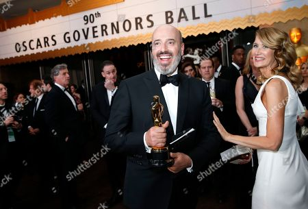 """Mark Bridges, Laura Dern. Mark Bridges, winner of the award for best costume design for """"Phantom Thread"""", left, and Laura Dern attend the Governors Ball after the Oscars, at the Dolby Theatre in Los Angeles"""