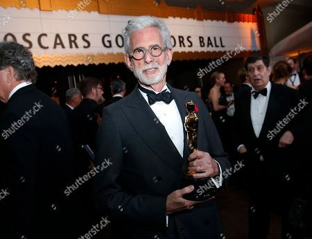 """Frank Stiefel, winner of the award for best documentary short subject for """"Heaven is a Traffic Jam on the 405"""", attends the Governors Ball after the Oscars, at the Dolby Theatre in Los Angeles"""