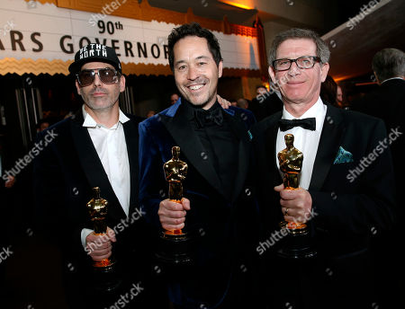 """Shane Vieau, Paul D. Austerberry, Jeffrey A Melvin. Shane Vieau, from left, Paul D. Austerberry, and Jeffrey A Melvin, winners of the award for best production design for """"The Shape of Water"""", attend the Governors Ball after the Oscars, at the Dolby Theatre in Los Angeles"""
