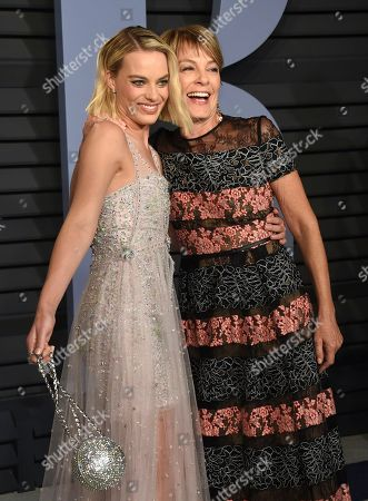 Stock Image of Margot Robbie, Sarie Kessler. Margot Robbie, left, and Sarie Kessler arrive at the Vanity Fair Oscar Party, in Beverly Hills, Calif