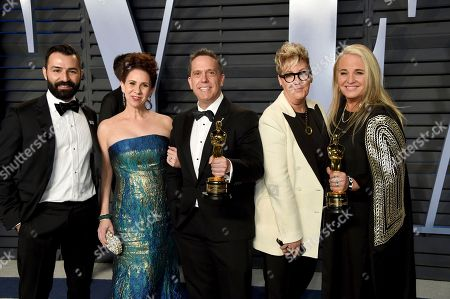"""Lee Unkrich, Darla K. Anderson. Lee Unkrich, center, Darla K. Anderson, right, and the team from """"Coco"""", winners of the award for best animated feature film, arrive at the Vanity Fair Oscar Party, in Beverly Hills, Calif"""