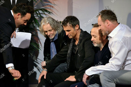 Declan Donnelly, with members of pop band Wet Wet Wet - Marti Pellow, Graeme Clark, Tommy Cunningham and Neil Mitchell.