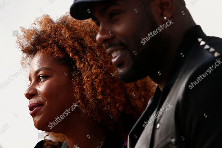 French judoka Teddy Riner and his partner Luthna Plocus attend Leonard ready-to-wear fall-winter 2018/2019 fashion collection presented in Paris