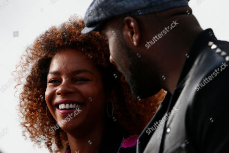 Stock Photo of French judoka Teddy Riner and his partner Luthna Plocus attend Leonard ready-to-wear fall-winter 2018/2019 fashion collection presented in Paris