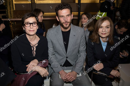 Kristin Scott Thomas, Arnaud Valois, Isabelle Huppert. Kristin Scott Thomas, Arnaud Valois and Isabelle Huppert pose for photographers prior to the Stella McCartney ready-to-wear fall/winter 2018/2019 fashion collection presented in Paris