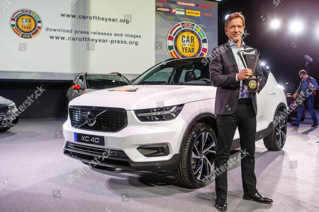 Hakan Samuelsson, CEO of Volvo Car Group, poses with the winner's trophy next to Volvo XC40 model after it was elected Car of the Year 2018, ahead of the 88th Geneva International Motor Show, at the Palexpo, in Geneva, Switzerland, 05 March 2018.