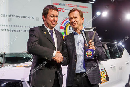 Frank Janssen (L), Jury President of the Car of the Year, congratulates Hakan Samuelsson, CEO of Volvo Car Group, next to a Volvo XC40 model after it was elected 'Car of the Year 2018', ahead of the 88th Geneva International Motor Show, at the Palexpo, in Geneva, Switzerland, 05 March 2018.