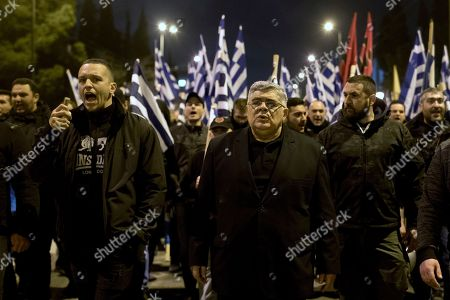 Ilias Kasidiaris, Nikos Mihaloliakos. Golden Dawn lawmaker Ilias Kasidiaris, left, shouts slogans next to Golden Dawn party leader Nikos Mihaloliakos during protest in central Athens on . About 500 members and supporters of the Nazi-inspired party, which is the fourth-largest in Greece's parliament, took part in the protest which follows the arrest last week, by Turkish forces, of two Greek soldiers patrolling the two countries' land border for allegedly illegally crossing into Turkey. Greek authorities say the soldiers crossed the border by mistake due to bad weather and poor visibility