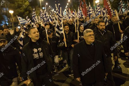 Ilias Kasidiaris, Nikos Mihaloliakos. Golden Dawn lawmaker Ilias Kasidiaris, left, and Golden Dawn party leader Nikos Mihaloliakos take part in a protest in central Athens on . About 500 members and supporters of the Nazi-inspired party, which is the fourth-largest in Greece's parliament, took part in the protest which follows the arrest last week, by Turkish forces, of two Greek soldiers patrolling the two countries' land border for allegedly illegally crossing into Turkey. Greek authorities say the soldiers crossed the border by mistake due to bad weather and poor visibility