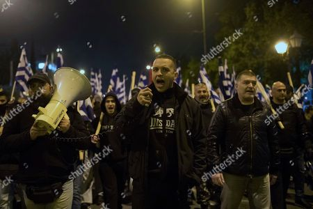 Golden Dawn lawmaker Ilias Kasidiaris, center, shouts slogans during protest in central Athens on . About 500 members and supporters of the Nazi-inspired party, which is the fourth-largest in Greece's parliament, took part in the protest which follows the arrest last week, by Turkish forces, of two Greek soldiers patrolling the two countries' land border for allegedly illegally crossing into Turkey. Greek authorities say the soldiers crossed the border by mistake due to bad weather and poor visibility