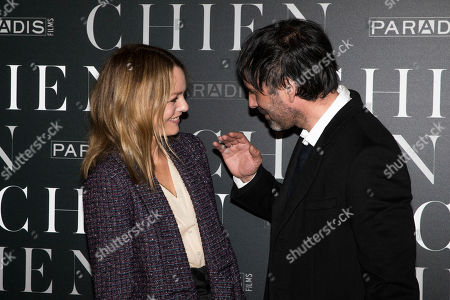 """French actress Vanessa Paradis, left, and French film director Samuel Benchetrit speak together as they arrive for the premiere of """"Chien"""" in Paris"""