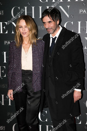 """French actress Vanessa Paradis, left, and French film director Samuel Benchetrit pose as they arrive for the premiere of """"Chien"""" in Paris"""