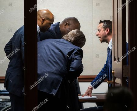 Stock Picture of Jared Even Moskowitz, Oscar Braynon, Bobby DuBose, Gary Farmer. Florida Rep. Jared Even Moskowitz, right, pulls in Sen. Oscar Braynon, left, Rep. Bobby DuBose, and Sen. Gary Farmer for a private room negotiation in the Senate chamber prior to debate on the Marjory Stoneman Douglas High School Student Safety Act at the Florida Capitol in Tallahassee, Fla