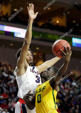 San Francisco's Souley Boum shoots covered by Gonzaga's Johnathan Williams during the first half of a West Coast Conference tournament NCAA college basketball game, in Las Vegas