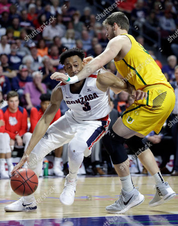 Gonzaga's Johnathan Williams drives past San Francisco's Jimbo Lull during the second half of a West Coast Conference tournament NCAA college basketball game, in Las Vegas