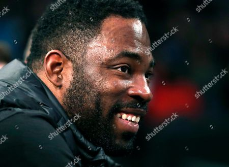Former New York Giants Super Bowl champion and defensive end Justin Tuck smiles while watching Serena Williams from a courtside seat during the Tie Break Tens tennis tournament at Madison Square Garden, in New York. The Tie Break Tens' New York event is a one-day day exhibition tournament featuring eight female players competing for a $250,000 winner's prize