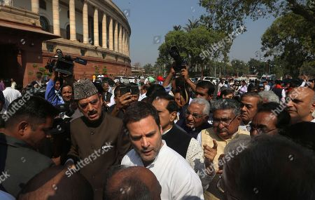 Indian Congress party president Rahul Gandhi, center, talks to congress party leaders during a protest outside the Indian parliament house, in New Delhi, India, . The protest was against ruling Bharatiya Janata party and billionaire jeweler Nirav Modi, for the alleged $1.8 billion bank fraud