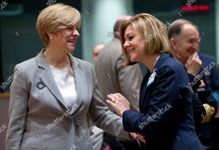 Italian Defense Minister Roberta Pinotti, left, speaks with Spanish Defense Minister Maria Delores de Cospedal Garcia during a meeting of EU defense ministers at the Europa building in Brussels on . EU defense ministers met in Brussels on Tuesday to discuss shortfalls in the bloc's training missions in Africa, plans for new joint military projects and relations with NATO