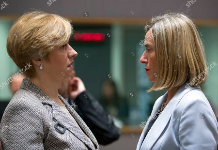 European Union foreign policy chief Federica Mogherini, right, speaks with Italian Defense Minister Roberta Pinotti during a meeting of EU defense ministers at the Europa building in Brussels on . EU defense ministers met in Brussels on Tuesday to discuss shortfalls in the bloc's training missions in Africa, plans for new joint military projects and relations with NATO
