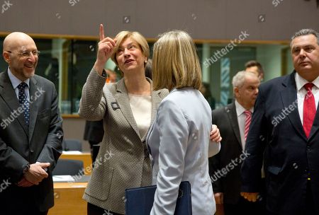 European Union foreign policy chief Federica Mogherini, center right, speaks with Italian Defense Minister Roberta Pinotti, center left, during a meeting of EU defense ministers at the Europa building in Brussels on . EU defense ministers met in Brussels on Tuesday to discuss shortfalls in the bloc's training missions in Africa, plans for new joint military projects and relations with NATO