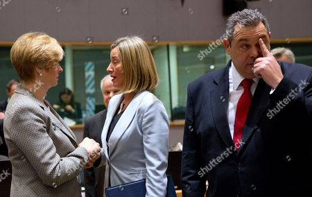 European Union foreign policy chief Federica Mogherini, center right, speaks with Italian Defense Minister Roberta Pinotti, left, during a meeting of EU defense ministers at the Europa building in Brussels on . EU defense ministers met in Brussels on Tuesday to discuss shortfalls in the bloc's training missions in Africa, plans for new joint military projects and relations with NATO. At right is Greek Defense Minister Panos Kammenos