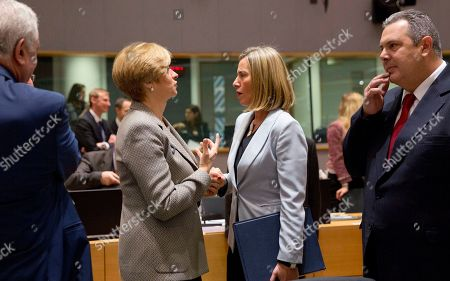 European Union foreign policy chief Federica Mogherini, center right, speaks with Italian Defense Minister Roberta Pinotti, center left, during a meeting of EU defense ministers at the Europa building in Brussels on . EU defense ministers met in Brussels on Tuesday to discuss shortfalls in the bloc's training missions in Africa, plans for new joint military projects and relations with NATO. At right is Greek Defense Minister Panos Kammenos