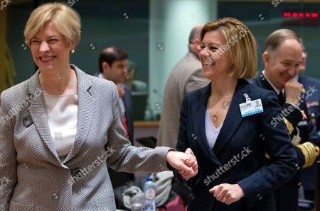 Spanish Defense Minister Maria Delores de Cospedal Garcia, right, speaks with Italian Defense Minister Roberta Pinotti during a meeting of EU defense ministers at the Europa building in Brussels on . EU defense ministers met in Brussels on Tuesday to discuss shortfalls in the bloc's training missions in Africa, plans for new joint military projects and relations with NATO