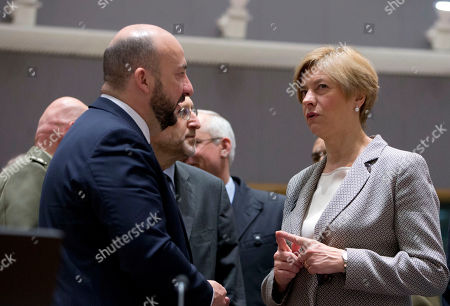 Italian Defense Minister Roberta Pinotti, right, speaks with Luxembourg's Defense Minister Etienne Schneider during a meeting of EU defense ministers at the Europa building in Brussels on . EU defense ministers met in Brussels on Tuesday to discuss shortfalls in the bloc's training missions in Africa, plans for new joint military projects and relations with NATO