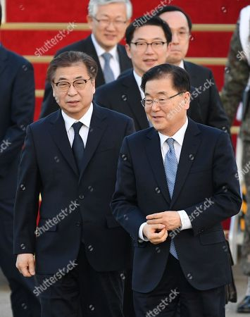 Chung Eui-yong (R), head of the presidential National Security Office, Suh Hoon (L), the chief of the South's National Intelligence Service, and other delegates (back) arrive at a military airport in Seongnam, South Korea, 06 March 2018. South Korean President Moon Jae-in's special envoys returned after meeting with North Korean leader Kim Jong-un on 05 March during an official visit to Pyongyang.