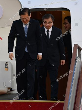 South Korean delegates Chung Eui-yong (L), head of the presidential National Security Office, Suh Hoon (R), the chief of the South's National Intelligence Service, and other delegates (not pictured) arrive at a military airport in Seongnam, South Korea, 06 March 2018. South Korean President Moon Jae-in's special envoys returned after meeting with North Korean leader Kim Jong-un on 05 March during an official visit to Pyongyang.