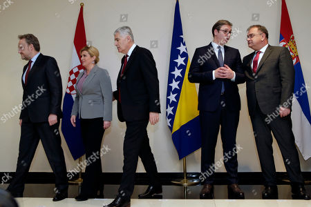 Bosnia summit. Presidents of Croatia, Bosnia and Serbia, from left to right, Bosnian Muslim member of Bosnian Presidency Bakir Izetbegovic, Croatian President Kolinda Grabar Kitarovic, Bosnian Croat member of Bosnian Presidency Dragan Covic, Serbian President Aleksandar Vucic and Bosnian Serb member of Bosnian presidency Mladen Ivanic, enter the meeting room during trilateral summit in Mostar, 140 kms south of Bosnian capital of Sarajevo