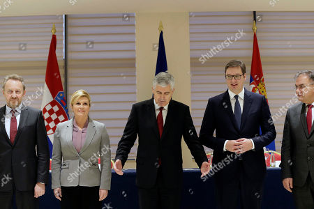 Bosnia summit. Presidents of Croatia, Bosnia and Serbia, from left to right, Bosnian Muslim member of Bosnian Presidency Bakir Izetbegovic, Croatian President Kolinda Grabar Kitarovic, Bosnian Croat member of Bosnian Presidency Dragan Covic, Serbian President Aleksandar Vucic and Bosnian Serb member of Bosnian presidency Mladen Ivanic, pose togehter for photo during trilateral summit in Mostar, 140 kms south of Bosnian capital of Sarajevo