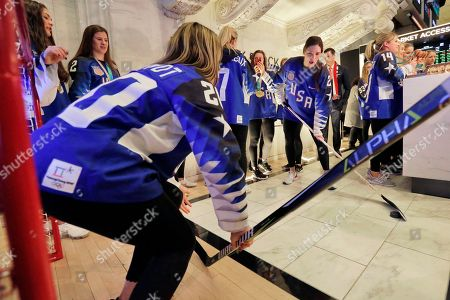 Hannah Brandt, Hilary Knight. U.S. Olympic gold medal women's hockey team forward Hannah Brandt, left, defends the goal as teammate Hilary Knight takes a shot, as the team visits the New York Stock Exchange trading floor, before ringing the opening bell