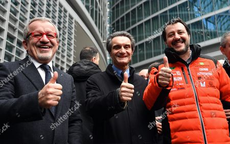 (L-R) Outgoing Lombardy Governor, Roberto Maroni, the new Lombardy Governor, Attilio Fontana, and League leader, Matteo Salvini, make a thumb up as they address the media in Milan, Italy, 06 March 2018. Salvini said Tuesday he was 'not budging' as the centre right's premier candidate having scored higher than Silvio Berlusconi in Sunday's general election.
