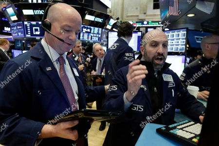 Patrick Casey, James Denar. Trader Patrick Casey, left, and specialist James Denaro work on the floor of the New York Stock Exchange, . U.S. stocks are little changed Tuesday as banks and big dividend payers decline while technology companies rise