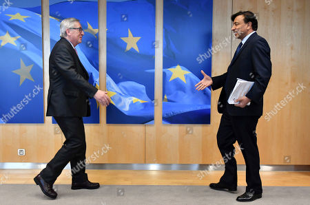 Lakshmi Mittal, right, CEO of ArcelorMittal, is greeted by European Commission President Jean-Claude Juncker at EU headquarters in Brussels on