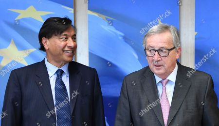 Lakshmi Mittal, left, CEO of ArcelorMittal, poses with European Commission President Jean-Claude Juncker prior to a meeting at EU headquarters in Brussels on